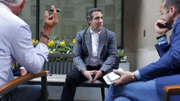 Donald Trump's lawyer: Michael Cohen with friends on Park Avenue in Manhattan last month. After FBI raids, the US department of justice announced it was placing him under criminal investigation. Photograph: Yana Paskova/Getty