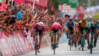 Elia Viviana (L) crosses the finish line in stage three of the Giro D'Italia. Photograph: Luk Benies/AFP