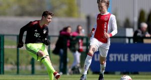 Bayern Munich's Benjamin Ballis in action against Ajax's  Julian Rijkhoff. All the talk prior to the final was about the latter a 13-year-old striker. Photograph: Tommy Dickson/Inpho