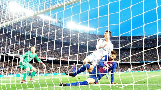 Cristiano Ronaldo scores Real Madrid's opener against Barcelona. Photograph: Lluis Gene/AFP