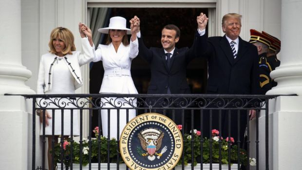 White House wave: Brigitte Macron, Melania Trump, Emmanuel Macron and Donald Trump on the White House balcony. Photograph: Al Drago/Bloomberg