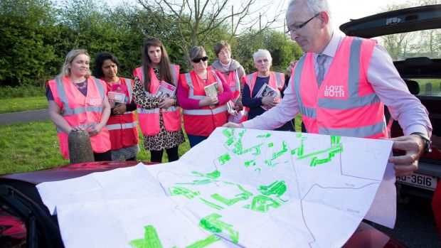 Paddy Rowland and a team of No campaigners check the area map for houses to canvass. Photograph: Tom Honan
