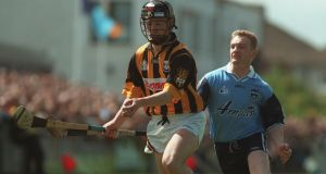 PJ Delaney of Kilkenny chased by Ruairi Boland of Dublin in the 1998 Leinster Hurling Championship. Photograph: Vesna Djilas/Inpho
