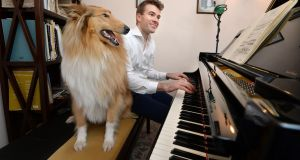 Fiachra Garvey rehearsing at home in Ballyknockan, Co Wicklow with his sheep dog Luas. He set up the West Wicklow Festival. Photograph: Cyril Byrne/The Irish Times