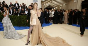 Gigi Hadid makes her entrance at the Met Gala at the Metropolitan Museum of Art in New York, May 1, 2017. Photograph: Benjamin Norman/The New York Times