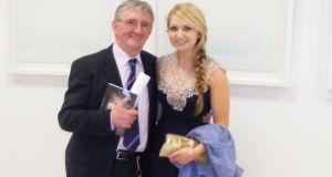 Nicky Brennan with his student Laura Maloney at her graduation