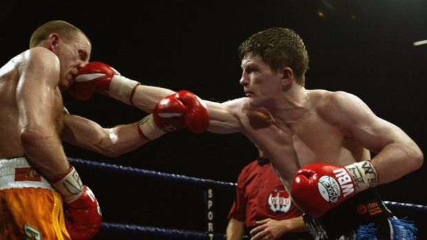 Hatton lands a punch on Magee during their fight in Manchester in 2002. Photo: Mark Thompson/Getty Images