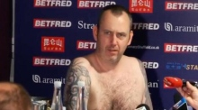 World snooker champion conducts naked press conference