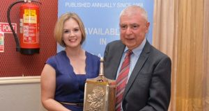 Hubert McHugh with his Leitrim Person of the Year 2017 award and his colleague Valerie Cogan