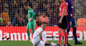 Cristiano Ronaldo injured his ankle in the process of scoring Real Madrid's first goal against Barcelona. Photograph: Alex Caparros/Getty