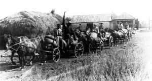 1932:  carts laden with bread supplies sent by the Bolsheviks from a collective farm leave Alekseyevka in the Kharkiv region of Ukraine. Photograph: Sovfoto/UIG via Getty Images