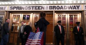 Attendees wait in front of the Walter Kerr Theater to see 'Springsteen on Broadway' in New York City. Photograph: Angela Weiss/AFP/Getty Images