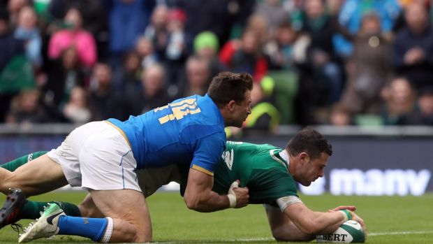 Ireland's Robbie Henshaw scores a try during the NatWest Six Nations match at the Aviva Stadium, Dublin, in February, with Italy's Tommaso Benvenuti on his back. Photograph: Brian Lawless/PA Wire