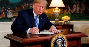 US President Donald Trump signs a proclamation declaring his intention to withdraw from the JCPOA Iran nuclear agreement  at the White House on Tuesday. Photograph: Jonathan Ernst/Reuters