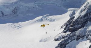 A helicopter distributes bait over an ice cap in South Georgia. Photograph: Tony Martin/PA Wire