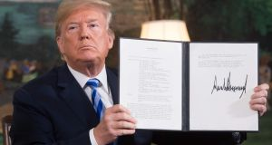 US president Donald Trump signs a document reinstating sanctions against Iran after announcing the US withdrawal from the Iran nuclear deal on Tuesday. Photograph: Saul Loeb/AFP/Getty Images