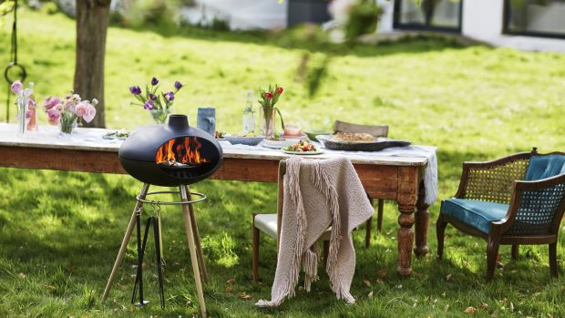 The Morsø Grill is an outdoor oven that lets you grill, roast and bake al fresco, using wood or briquettes as fuel