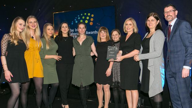 Lisa Keating, Scientific Programme Manager, Programmes Directorate, Science Foundation Ireland, presents the Laboratory Team of the Year award to Microbiology Laboratory, Tallaght University Hospital team.