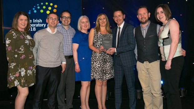 David Bryant, Segment Programme Manager, Speciality and Medical Gases, Air Products presents the Bio Science Laboratory of the Year award to Pfizer Grange Castle team.