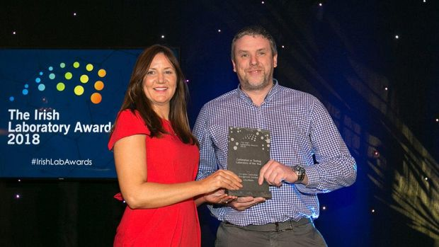 Matt Moran, Director, BioPharmaChem Ireland presents the Calibration or Testing Laboratory of the Year award to the Tom McGuinn, LotusWorks.
