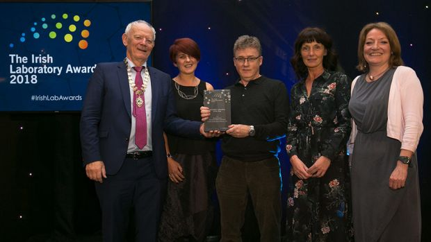 Conor O'Brien, President, Irish Science Teachers Association, presents the Education Laboratory of the Year award to School of Biological Sciences, DIT team.