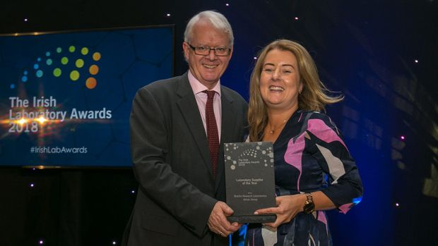 Matt Moran, Director, BioPharmaChem Ireland, presents the Laboratory Supplier of the Year award to Roisin Browne, BioClin Research Laboratories - Almac Group.