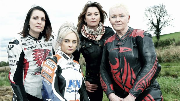 Yvonne Montgomery (right) and fellow female road racers Veronika Hankocyova and Melissa Kennedy with TV presenter Suzi Perry at the 2017 Cookstown 100 road races. Photograph: Stephen Davison