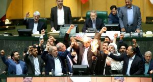 Iranian MPs burn a US flag in the parliament in Tehran following  US president Donald Trump's decision to withdraw from the nuclear accord. Photograph: AFP