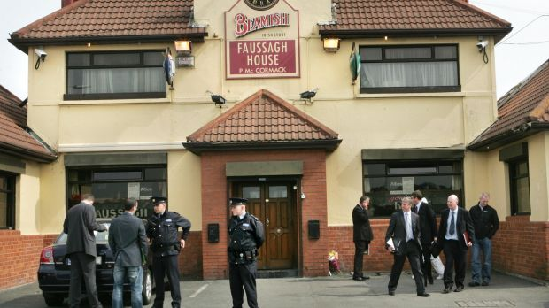 Gardaí attend the scene of the murder of gang leader Eamon Dunne in the Fassaugh House pub in Cabra, north Dublin, in April 2010. Photograph : Matt Kavanagh