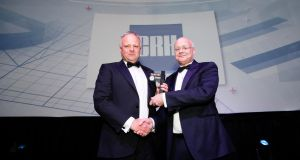 Shaun Murphy (right), managing partner at KPMG presents The Irish Times Company of the Year Award 2018 to Mark Cahalane, head of group corporate affairs at CRH.