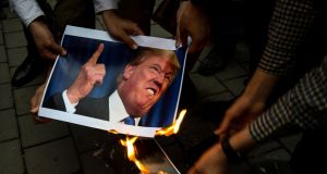 Iranians burn a photograph of US president Donald Trump during an anti-US demonstration outside the former American embassy HQ in Tehran, on Wednesday. Photograph: Ali Mohammadi/Bloomberg