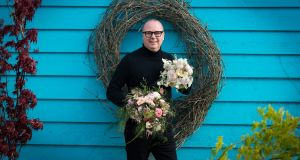 Lamber de Bie with the bouquets he's created ahead of the Royal wedding. Photograph: Dylan Vaughan