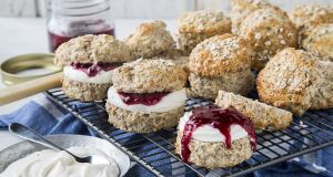 Wholemeal brown scones with cream and jam. Photograph: Harry Weir