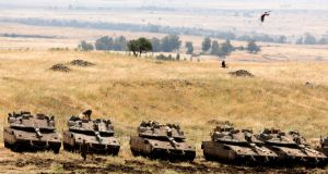 Israeli Merkava tanks in a deployment area near the Syrian border in the Israel-annexed Golan Heights on Thursday. Photograph: Menahem Kahana/AFP/Getty Images