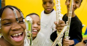 OrchKids: children from Baltimore's OrchKids initiative, which provides instruments, music education, academic instruction and healthy food. Photograph: Bill Dennison