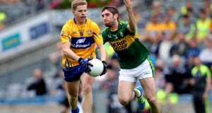 Clare's Podge Collins and Shane Enright of Kerry. Photograph: Inpho/Ryan Byrne