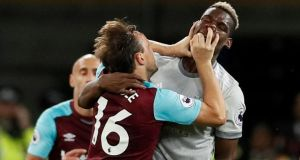 West Ham United's Mark Noble clashes with Manchester United's Paul Pogba. Photograph: Reuters