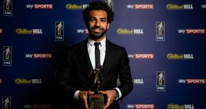 Liverpool's Mohamed Salah with the FWA Footballer of the Year 2018 award. Photograph: Steven Paston/PA