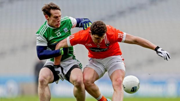 Armagh's Patrick Burns and Tomas Corrigan of Fermanagh