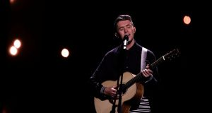 Ireland's Ryan O'Shaughnessy, 25-year-old singer-songwriter from Skerries, performs 'Together' at the Altice Arena hall in Lisbon. Photograph: Reuters/Rafael Marchante