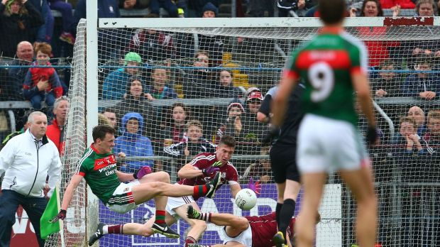 Galway's Johnny Heaney stops a goal-bound shot from Mayo's Diarmuid O'Connor in Championship semi-final at Pearse Stadium last year. Photograph: Cathal Noonan/Inpho