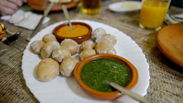 "Local speciality, papas arrugadas con mojo, which translates as ""wrinkled potatoes in a sauce"" (these are addictive small potatoes boiled in salt water and served with a chili and garlic sauce)."