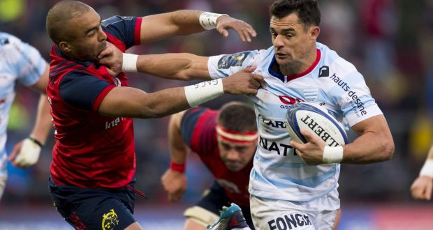 9bfe193d75ba Dan Carter of Racing 92 is tackled by Simon Zebo of Munster during a  Champions Cup