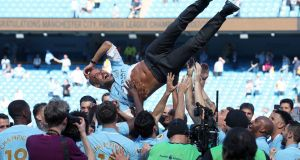 Manchester City manager Pep Guardiola is thrown  into the air as  players  celebrate winning the  Premier League  at the Etihad Stadium, Manchester. Photograph: Martin Rickett/PA Wire