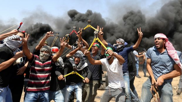 Palestinian demonstrators, some brandishing wire-cutters, gesticulate during a protest demanding the right of return at the Israel-Gaza border in the southern Gaza Strip, on Friday. Photograph: Ibraheem Abu Mustafa/Reuters