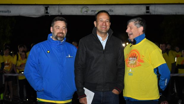Taoiseach Leo Varadkar (centre) is joined Brian Higgins (left) chief executive of Pieta House and Pat O'Doherty chief executive of ESB in Dublin's Phoenix Park where 15,000 people took part in this year's Darkness Into Light walk. Photograph: SportsFile