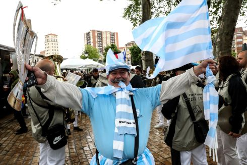 A Racing fan shows his support ahead of the game. Photograph: Inpho