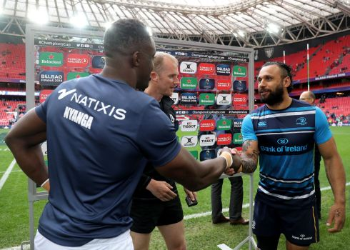 Yannick Nyanga and Isa Nacewa of Leinster with referee Wayne Barnes at the coin toss. Photograph: Inpho