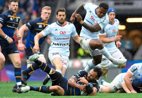 Racing 92's New Zealand-born French centre Virimi Vakatawa challenges Isa Nacewa. Photograph: Getty Images