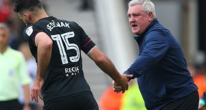 Mile Jedinak of Aston Villa celebrats with Steve Bruce at the Riverside Stadium. Photograph: Alex Livesey/Getty Images
